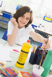 A schoolgirl in an art class.  royalty free stock photography