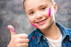 Schoolgirl artist with painted face Stock Photo