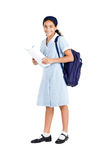 Schoolgirl with backpack. Happy little schoolgirl with backpack and book over white Royalty Free Stock Photography