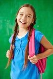 Schoolgirl with backpack Royalty Free Stock Image