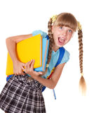 Schoolgirl with backpack holding books. Royalty Free Stock Image
