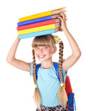 Schoolgirl with backpack holding books. Stock Photo