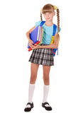 Schoolgirl with backpack holding books. Stock Images