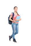 Schoolgirl with backpack holding notebooks Royalty Free Stock Images