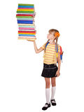 Schoolgirl with backpack holding pile of books. Stock Photos