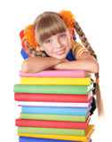 Schoolgirl with backpack holding pile of books. Royalty Free Stock Photos