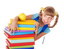 Schoolgirl with backpack holding pile of books. Royalty Free Stock Images