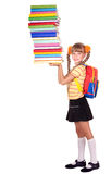 Schoolgirl with backpack holding pile of books. Stock Image