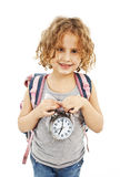 Schoolgirl with backpack showing alarm clock Royalty Free Stock Photos