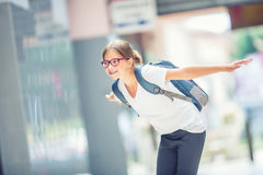 Schoolgirl with bag, backpack. Portrait of modern happy teen school girl with bag backpack. Girl with dental braces and glasses Stock Photography