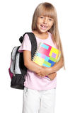 Schoolgirl with bag and books Stock Image