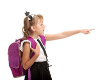 Schoolgirl with bag pointing Stock Photography