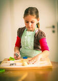 Schoolgirl Baking Cookies Stock Photos