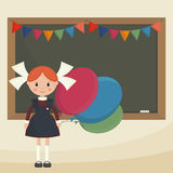 Schoolgirl with balloons Royalty Free Stock Image