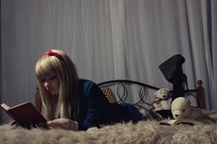 Schoolgirl in the bed Stock Photography