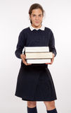 Schoolgirl with big books Stock Image