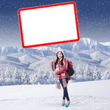 Schoolgirl with billboard at mountain Stock Photo