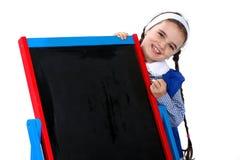 Schoolgirl at blackboard Royalty Free Stock Photography