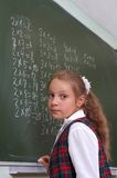Schoolgirl at the blackboard. Stock Photography