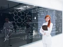 Schoolgirl at the blackboard Royalty Free Stock Image