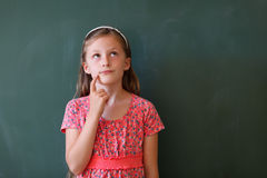 Schoolgirl and blackboard with copy space Royalty Free Stock Photo