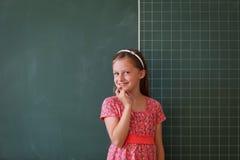 Schoolgirl and blackboard with copy space Stock Photos