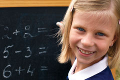 Schoolgirl at the blackboard Stock Photo