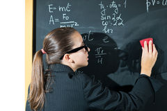 Schoolgirl at the blackboard Royalty Free Stock Photos