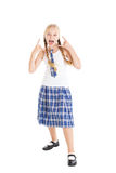 Schoolgirl blonde with two braids in school uniform. The girl opened her mouth. Studio shot, isolated on white background royalty free stock images