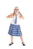 Schoolgirl blonde with two braids wearing a school uniform and black-framed glasses. Royalty Free Stock Image