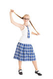 Schoolgirl stretches aside their long braids. Royalty Free Stock Images