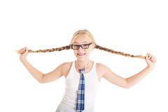 Schoolgirl stretches aside their long braids. Stock Photography
