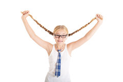Schoolgirl stretches aside their long braids. Royalty Free Stock Photo