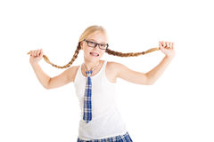 Schoolgirl stretches aside their long braids. Royalty Free Stock Photos
