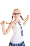 Schoolgirl stretches aside their long braids. Stock Images