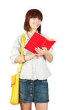 Schoolgirl with book Royalty Free Stock Images