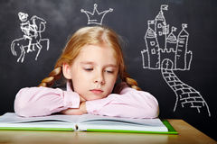 Schoolgirl with a book Stock Photography