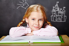 Schoolgirl with a book Stock Photo