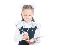 Schoolgirl with a book in hand Stock Images