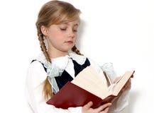 The schoolgirl with book in hands Stock Photo