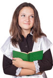 Schoolgirl with a book in his hands Royalty Free Stock Photo