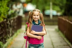 Schoolgirl with the book Royalty Free Stock Photo