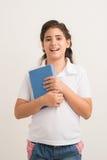 Schoolgirl with a book Stock Photos