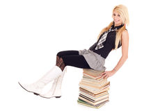 Schoolgirl on book stack Royalty Free Stock Images