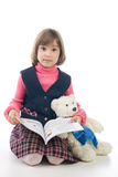 Schoolgirl with book and Teddy Bear Royalty Free Stock Images
