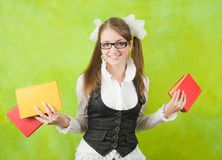Schoolgirl with books Stock Image