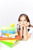 Schoolgirl and books and apple Stock Photos