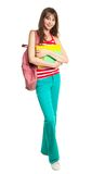Schoolgirl with books and backpack Stock Photos