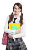 Schoolgirl with books, backpack and ponytails Stock Image