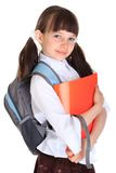 Schoolgirl with books and bag Royalty Free Stock Photo